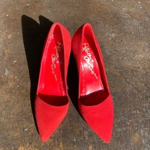 Red suede pointy toe pumps